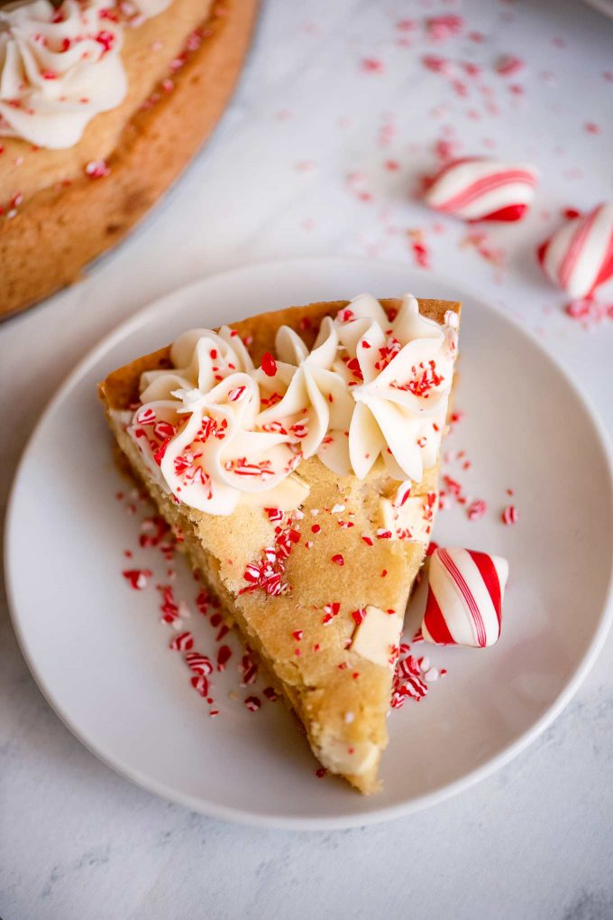 slice of a cookie cake on white plate with peppermint