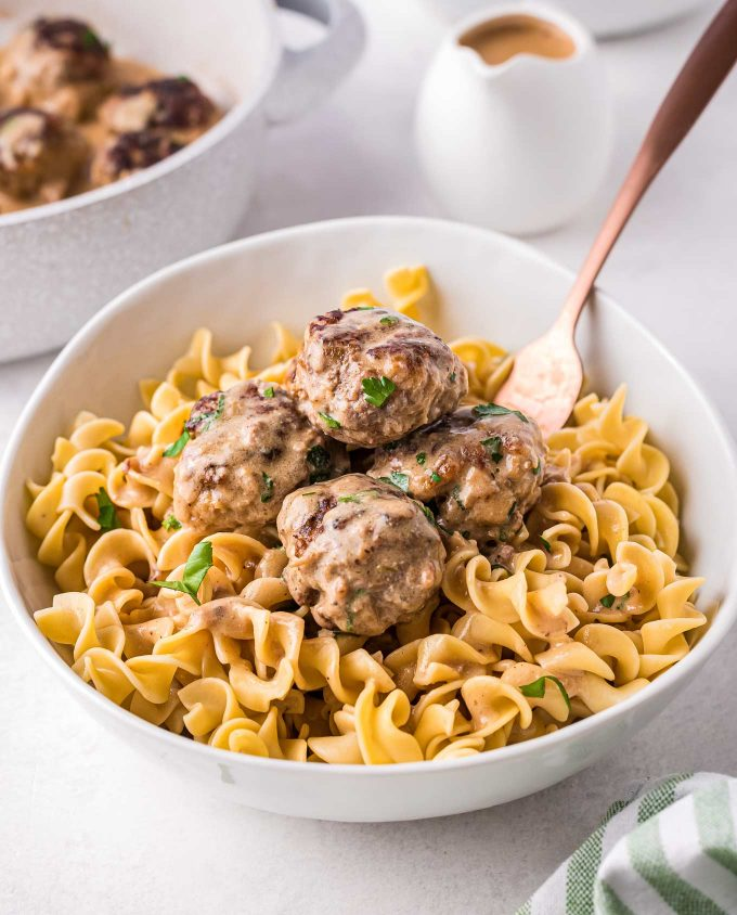 bowl of egg noodles and meatballs