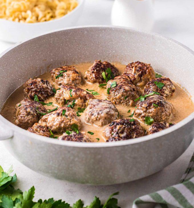 braising pan full of swedish meatballs in sauce