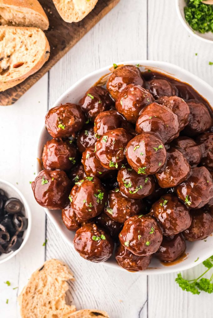 pile of meatballs in white bowl for a party