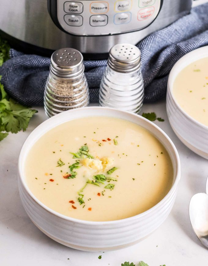 two bowls of cauliflower soup by instant pot