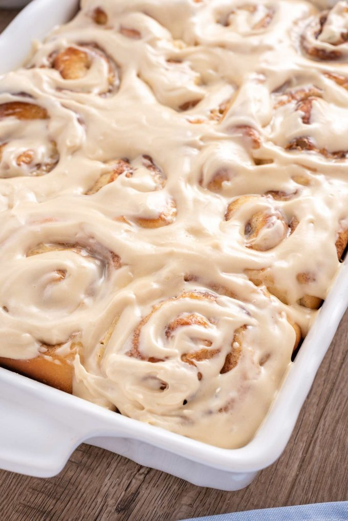 baking pan of cinnamon rolls with cream cheese icing