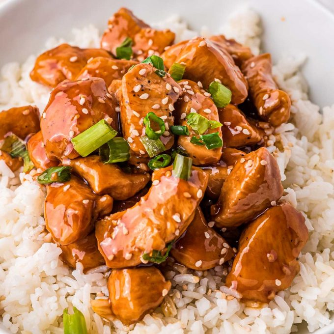 pile of bourbon chicken served over rice