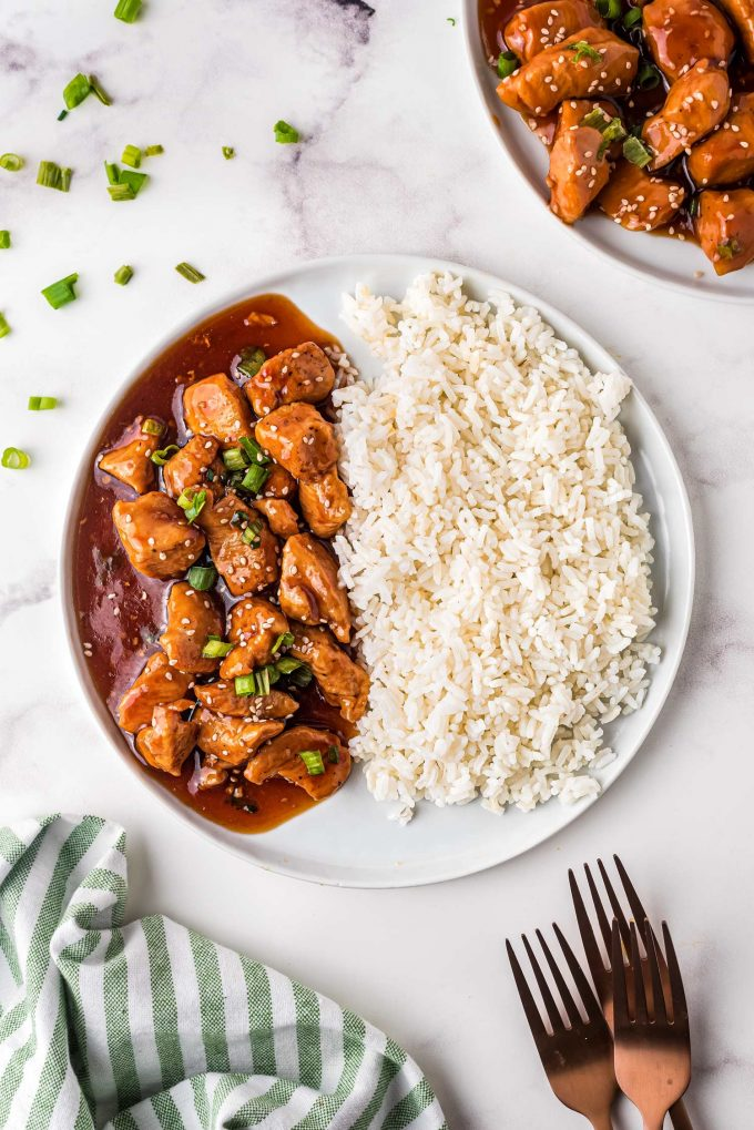 saucy chicken in bourbon sauce on plate with rice