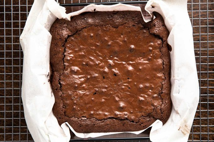 baked brownies in pan with parchment paper