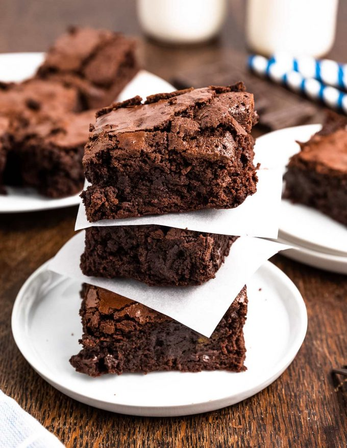 stack of brownies with parchment squares