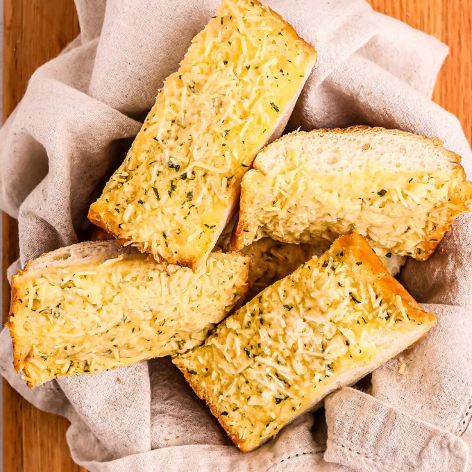 pile of garlic bread slices in bread basket