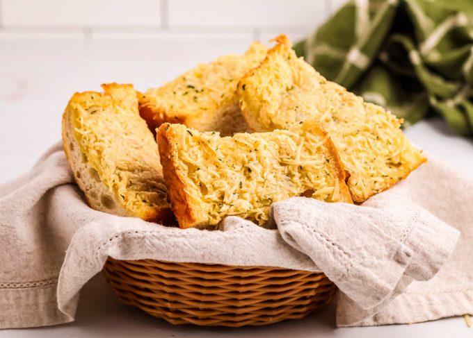 basket of garlic bread slices