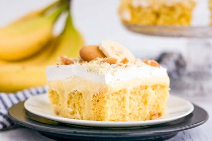 slice of banana pudding poke cake on white plate