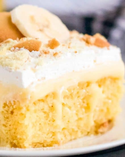 This Banana Pudding Poke Cake is the easiest and most delicious banana dessert around! Buttery yellow cake is infused with banana pudding, then slathered with whipped cream, crushed vanilla wafers and banana slices! Naturally a make ahead dessert, this is a dessert recipe the whole family will love! #pokecake #yellowcake #bananapudding #dessert #baking