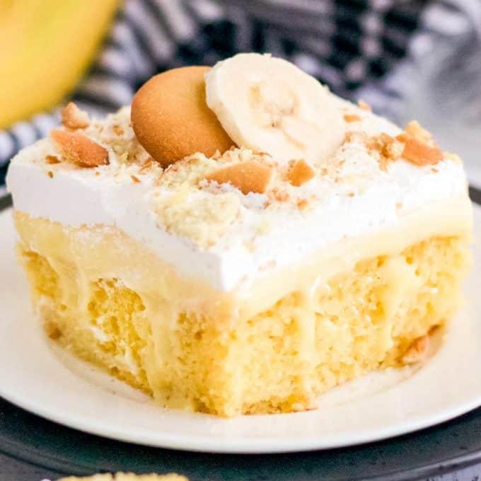 slice of banana poke cake on white plate