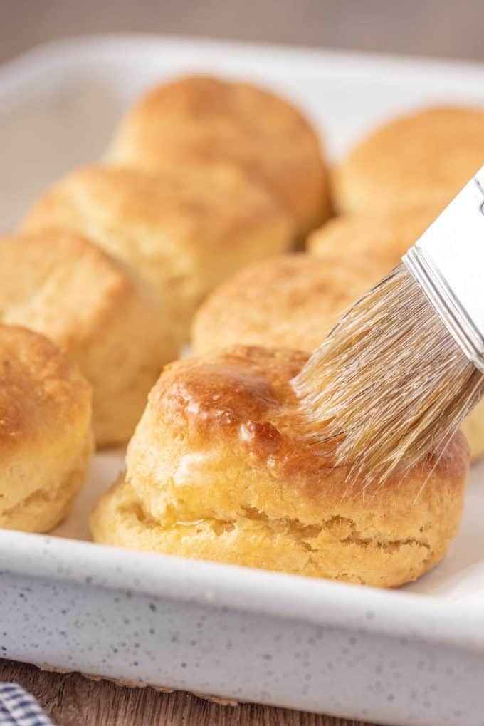 brushing biscuit with melted butter
