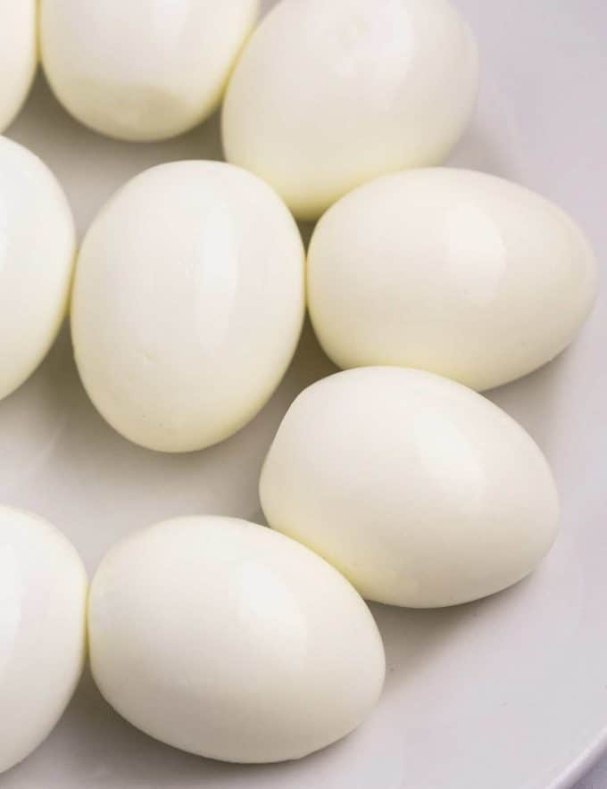 plate of peeled hard boiled eggs