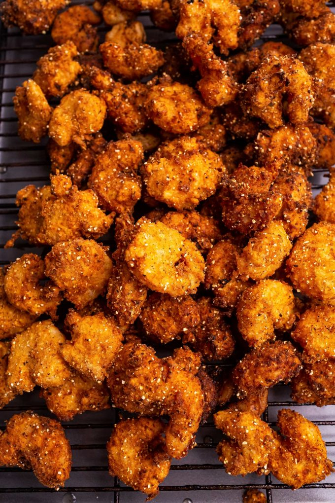 These Southern-Style Fried Shrimp are so juicy and tender, with the crispiest crust.  Deep fried in a buttermilk and flour/cornmeal batter, they're perfect with cocktail sauce as an appetizer, or a fun dinner! #shrimp #friedshrimp #popcornshrimp #seafood #southernfood