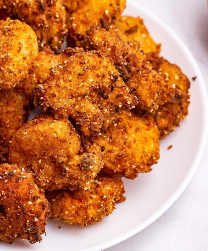 pile of fried shrimp on white plate