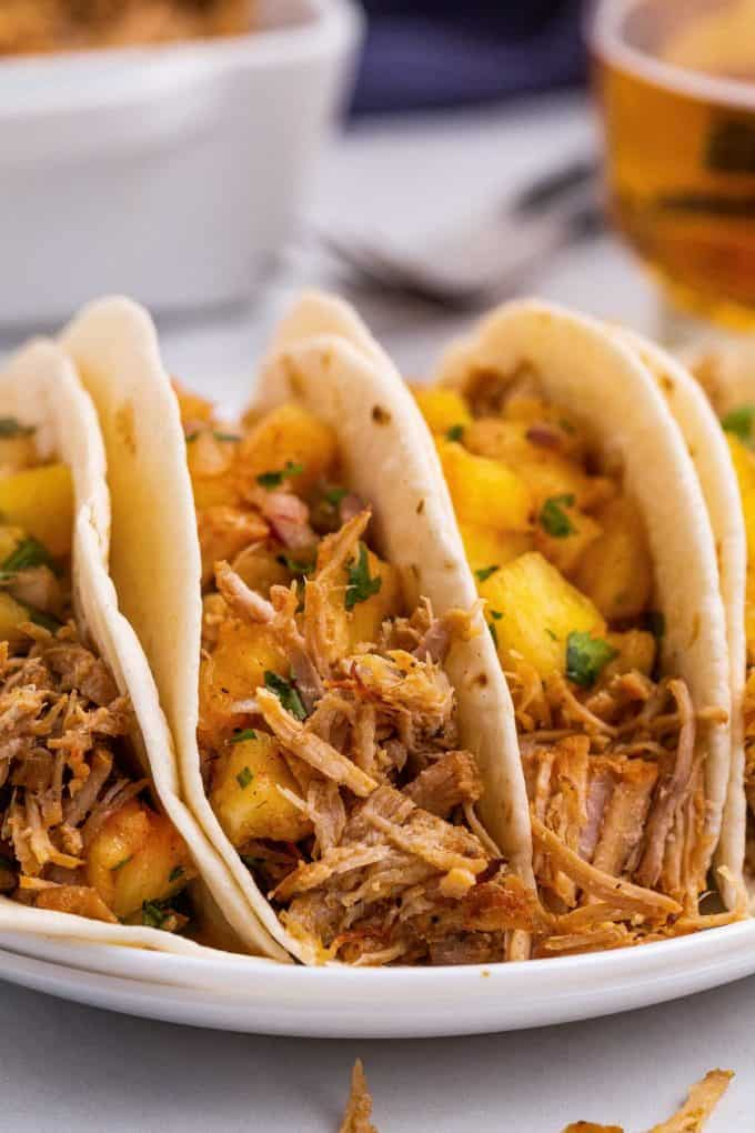 three shredded pork tacos