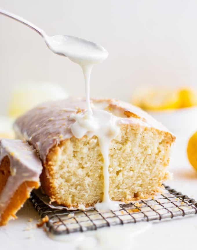 pouring glaze over lemon pound cake
