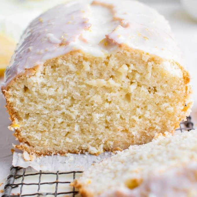 sliced loaf of lemon pound cake with glaze