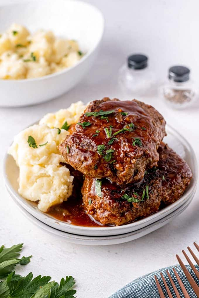 stout bbq salisbury steaks on plate with mashed potatoes
