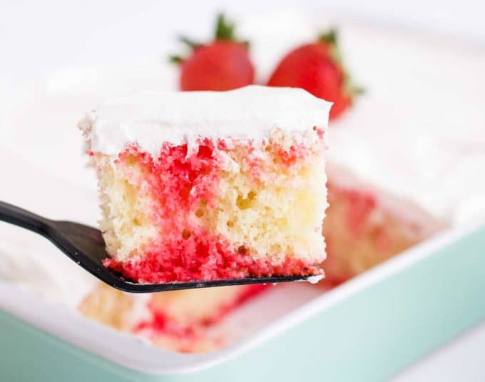 piece of strawberry poke cake on spatula