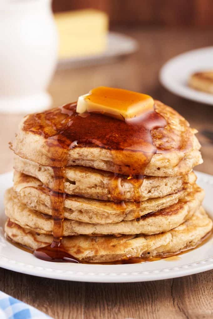 syrup poured over stack of pancakes