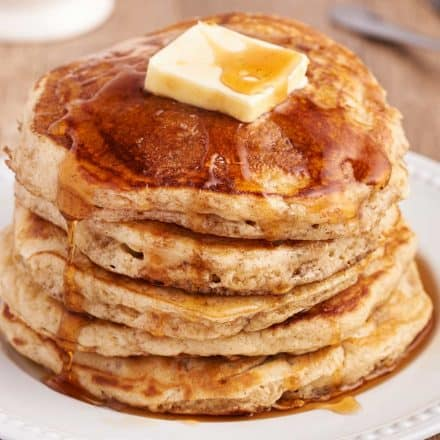 stack of buttermilk pancakes on white plate