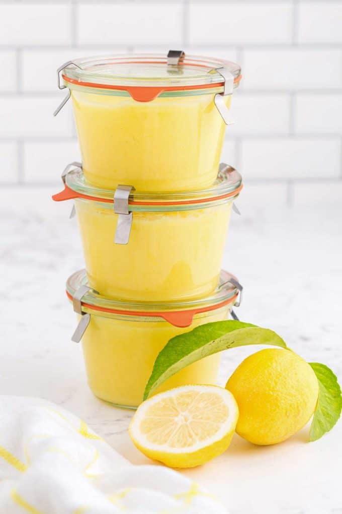 glass jars of lemon curd stacked on top of one another