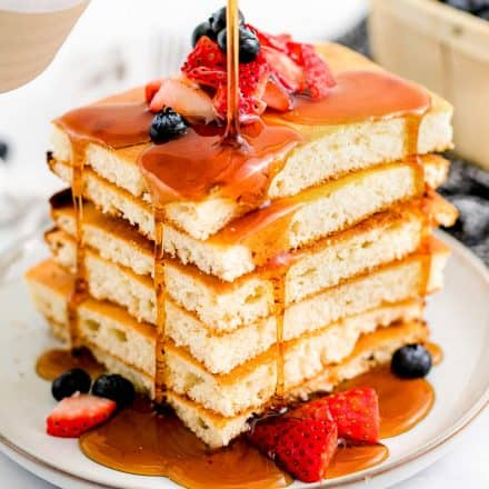stack of sheet pan pancakes with maple syrup