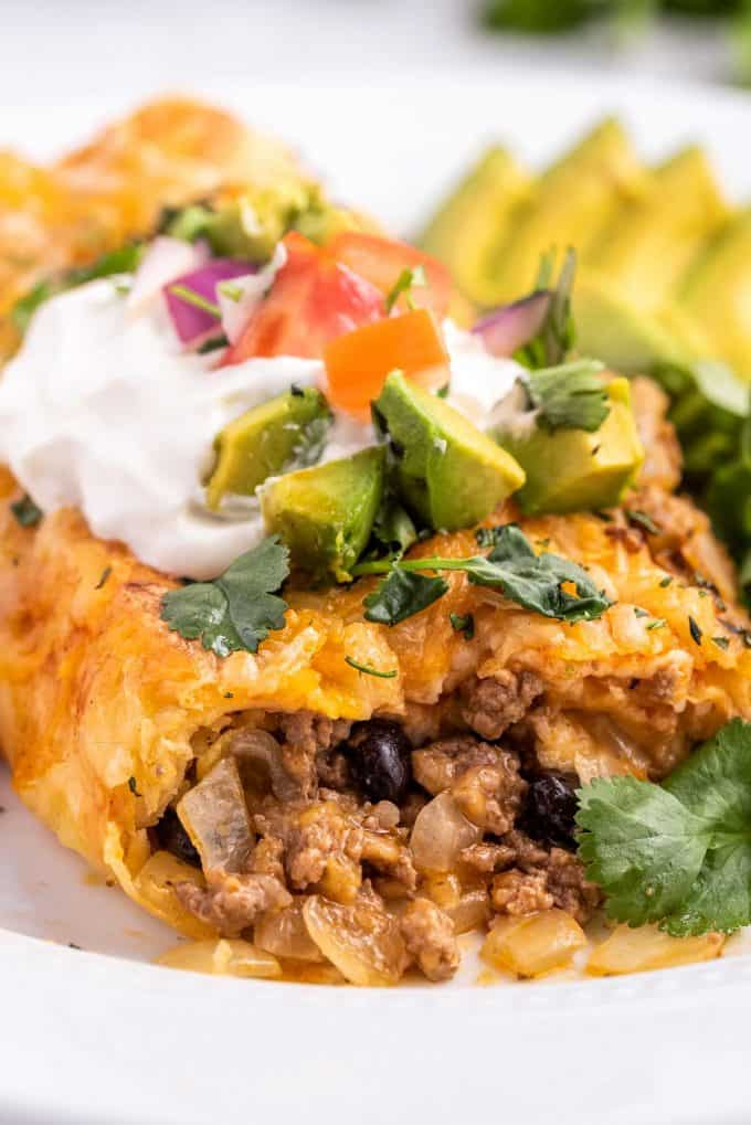 close up of cheesy ground beef filling of enchilada