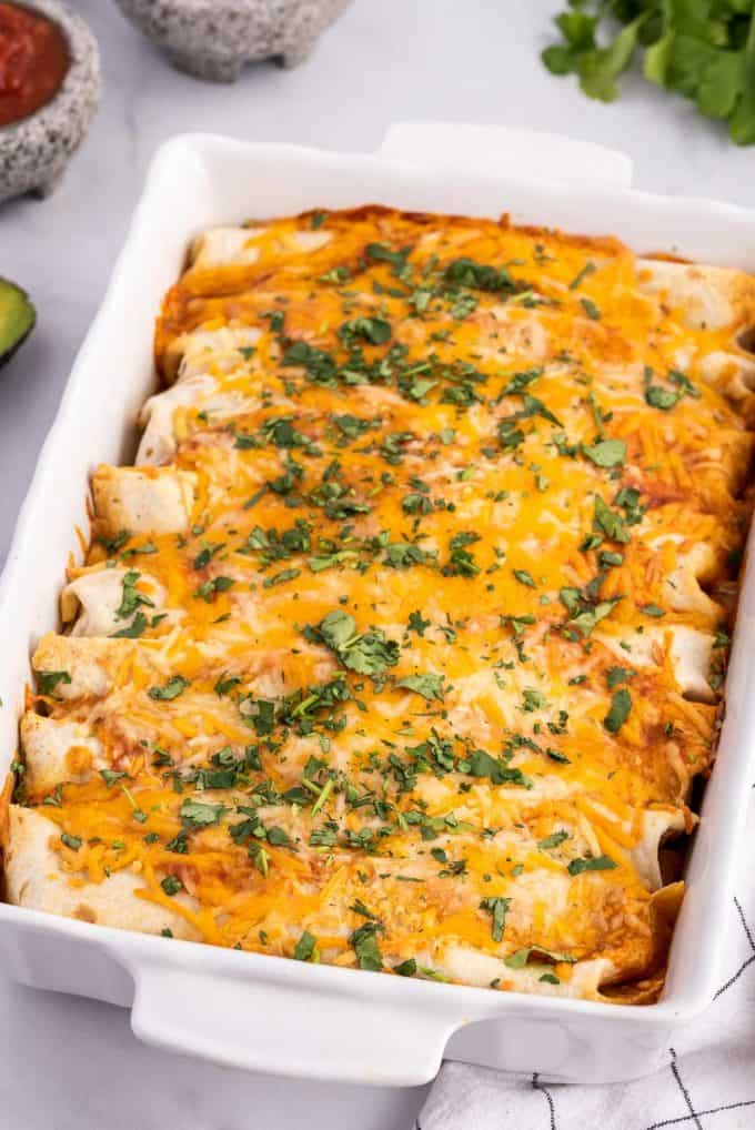 cheesy ground beef enchiladas in baking dish