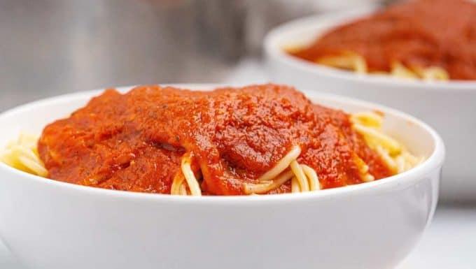 spaghetti covered in marinara sauce
