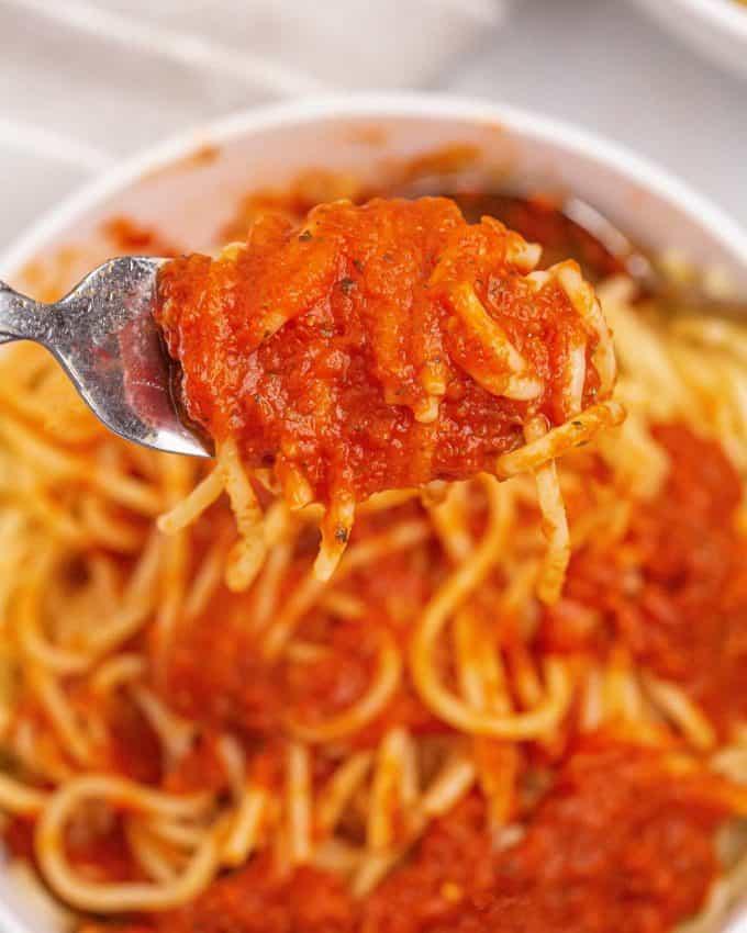 pasta twirled around a fork with pasta sauce