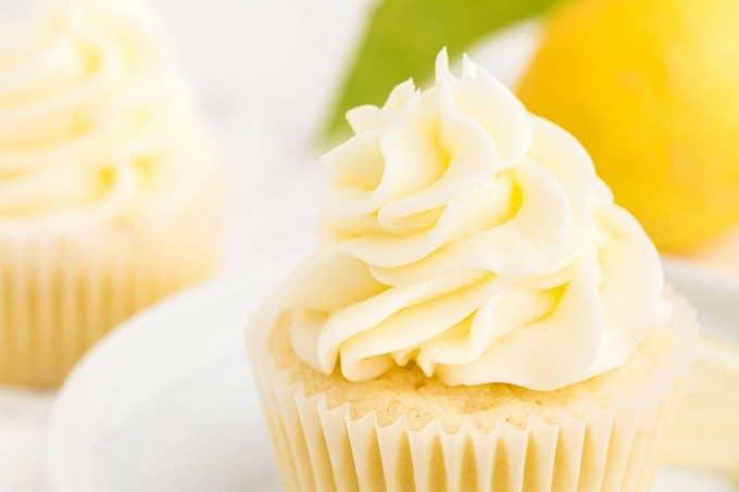lemon cupcakes with lemon buttercream frosting on top