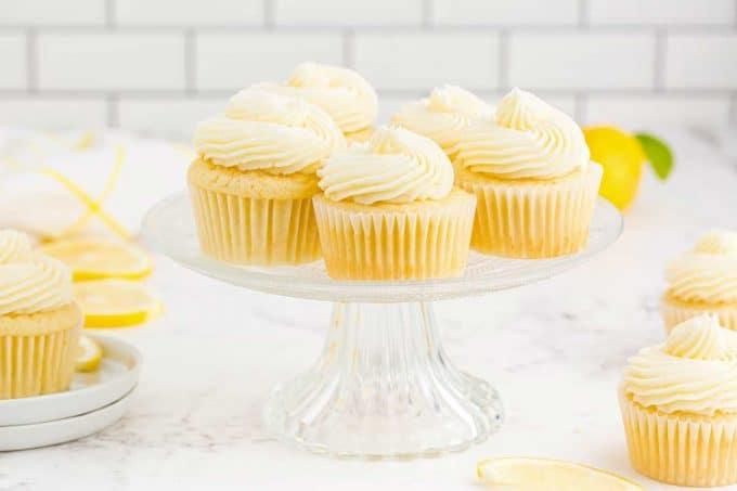 lemon cupcakes on glass cake stand