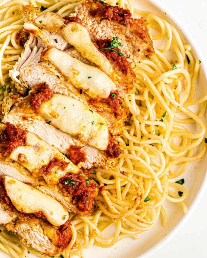 sliced chicken parmesan with spaghetti