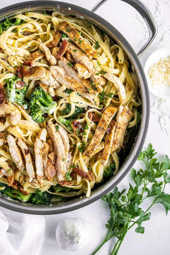 overhead view of fettuccine alfredo with chicken in skillet
