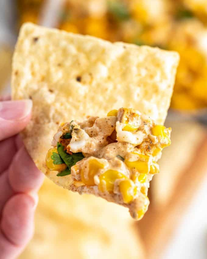 tortilla chip with scoop of elote dip