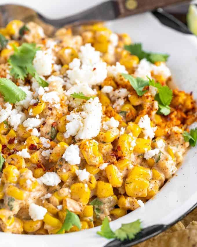 mexican street corn dip in white bowl