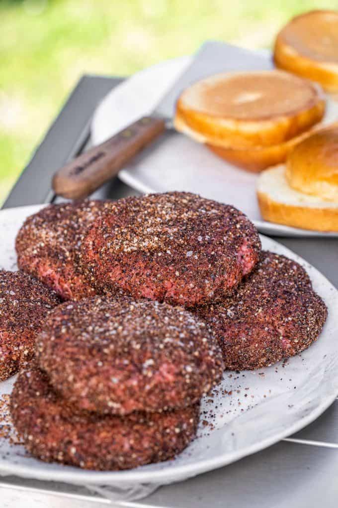 preparing to grill hamburgers
