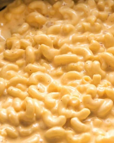 This ultra creamy Mac and Cheese recipe is made right in your slow cooker! Loved by both kids and adults, it's perfect for parties, potlucks, and more! #macandcheese #crockpot #slowcooker
