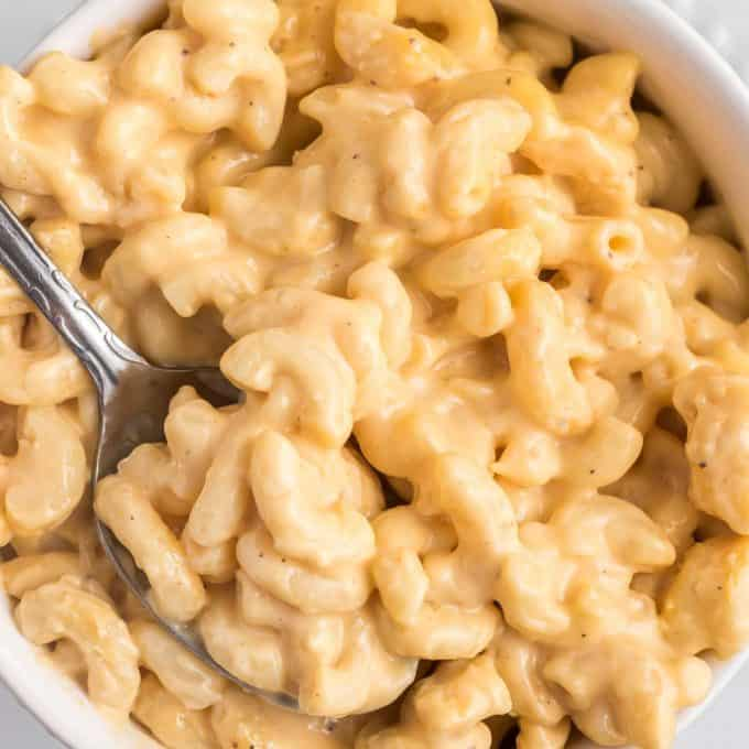 bowl of creamy mac and cheese with a spoon