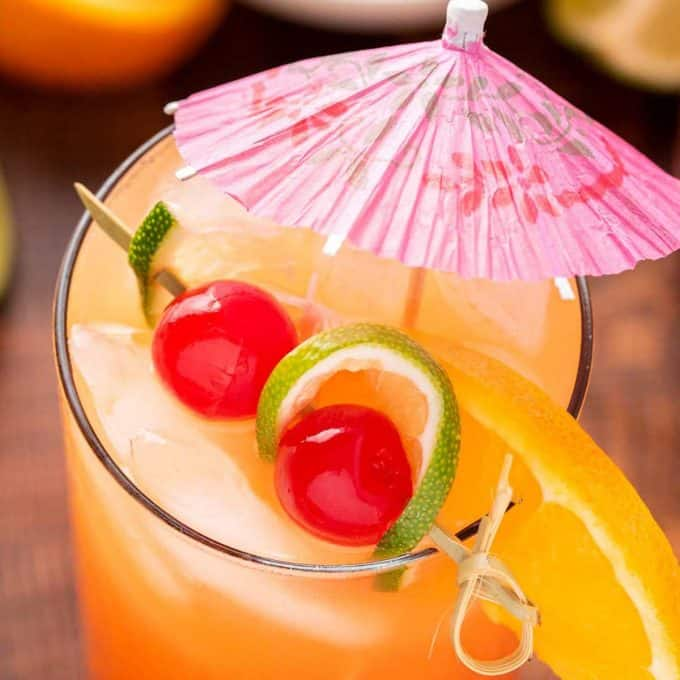 rum punch with paper umbrella garnish