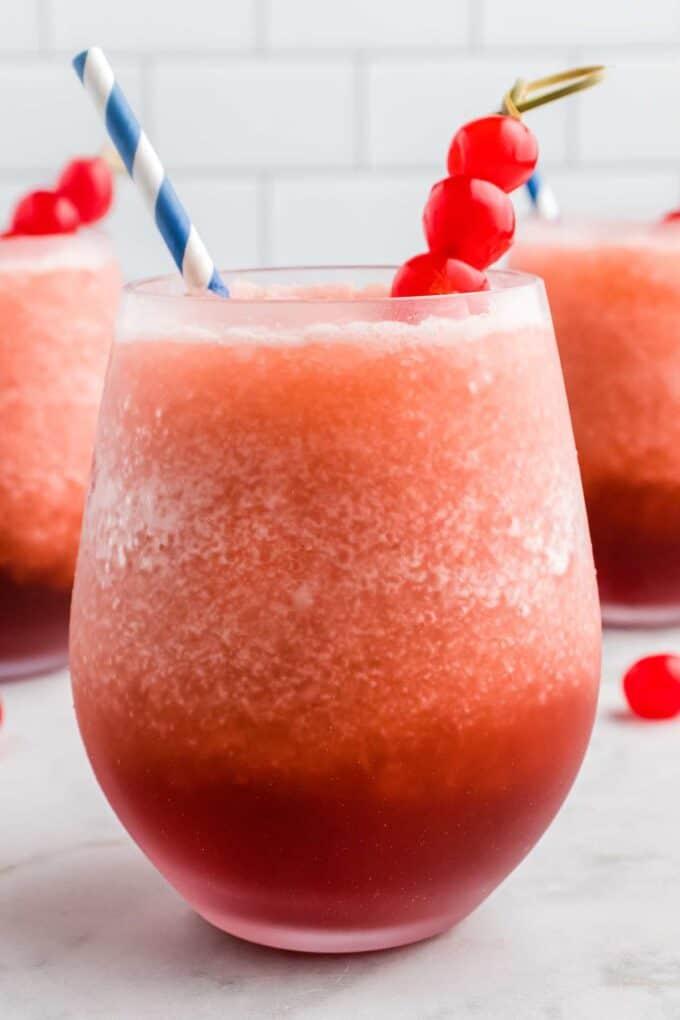 frosty glass of bourbon slush with cherries
