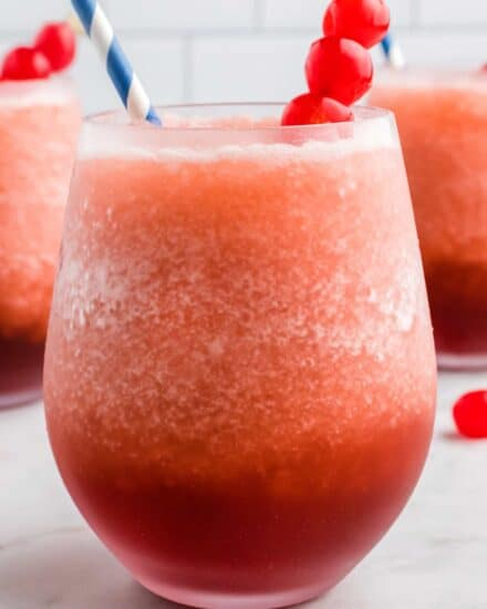This Cherry Cola Bourbon Slush is our favorite frozen cocktail! Made with just 4 ingredients (including ice!), it's so easy to whip together and enjoy all year round! #slush #bourbon #cherry