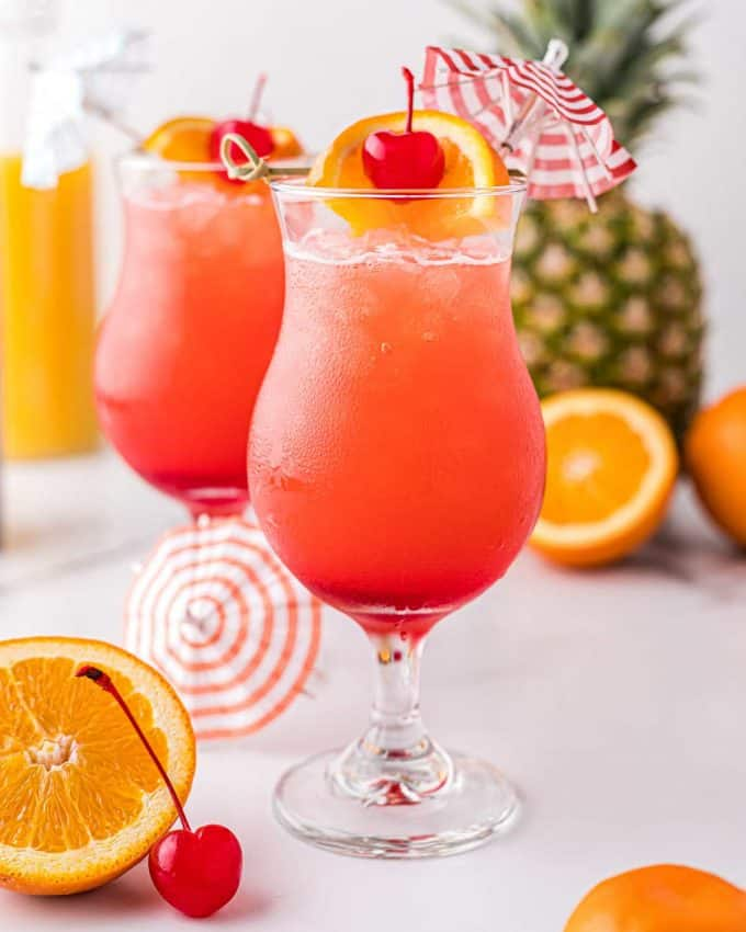 garnished cocktail in hurricane glass