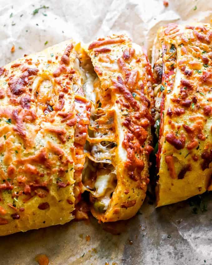 cheese pull between stromboli slices