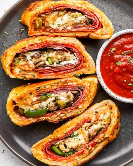 This Stromboli is loaded with Italian meats, cheeses and vegetables, and all wrapped up in a crispy cheesy crust. Like a deluxe pizza, all rolled up like a burrito. Great for a busy weeknight when you use store bought pizza dough! #pizza #stromboli #italian
