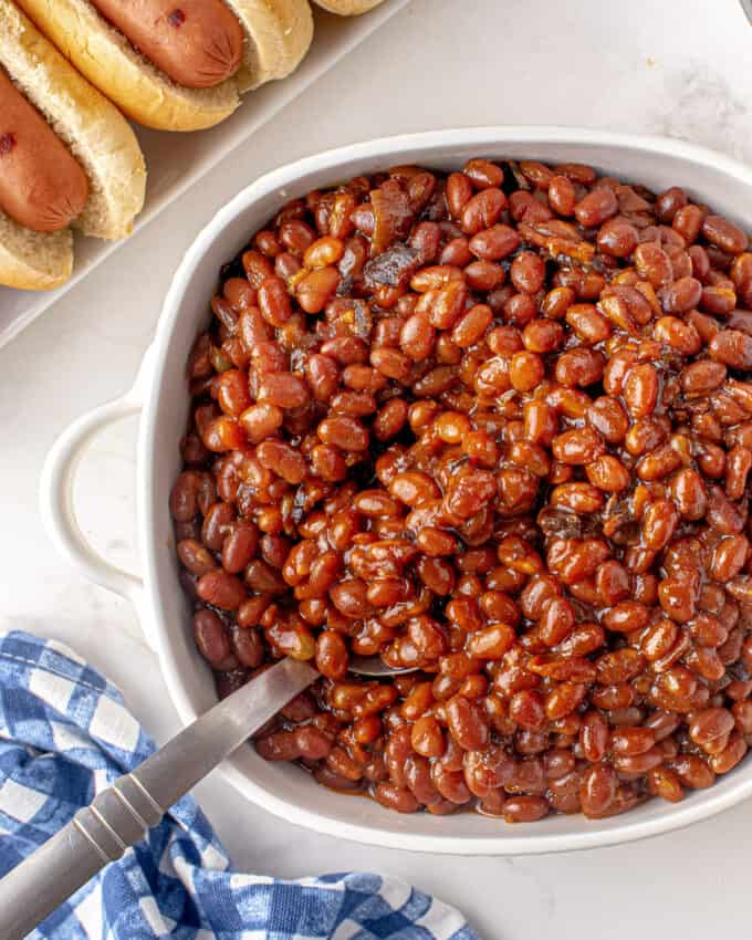 dish with baked beans and spoon