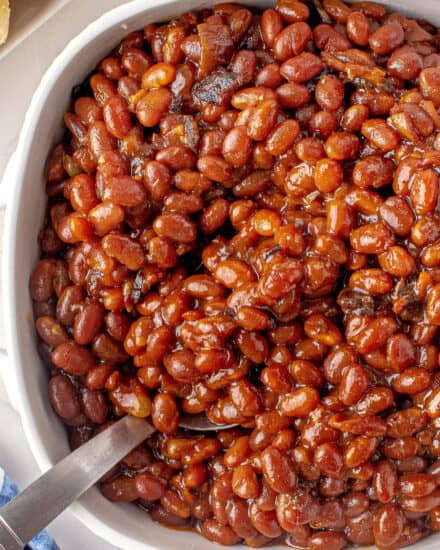 """These Instant Pot """"Baked"""" Beans are smoky, thick, tangy and sweet. Perfect as an easy side dish for any meal, and easy to make vegetarian if you prefer! #bakedbeans #instantpot #pressurecooker"""