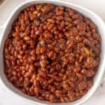 white bowl of baked beans
